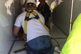Students practicing rope access training in a confined space