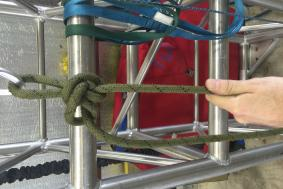 Technician demonstrating proper rope tying methods for rope access training