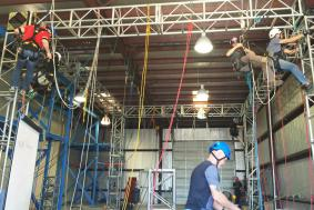 Students at rope access training facility practicing rope training