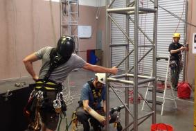 Technicians preparing facility for to practice rope access training