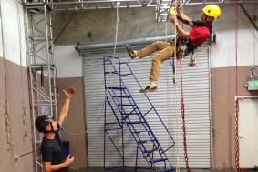 Rope access technician instructing trainee