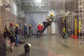 Technician demonstrating to trainees during rope access training