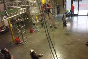 Man practicing rope access training in training facility