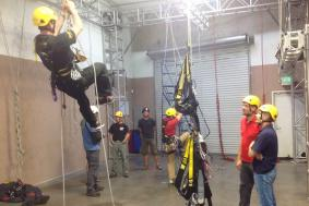 Rope access trainer demonstrating to students