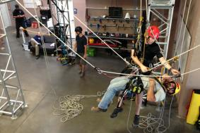 Trainer working with student on proper rope access training procedures