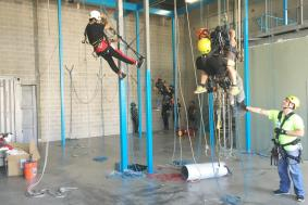 Technician on the floor instructing students on rope proper rope training procedures