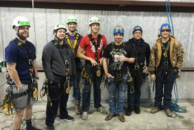 Students preparing for rope access training at training facility