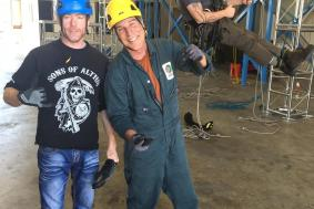 Students on ground observing rope access training technician