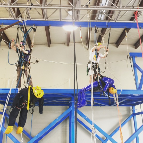 Rope access trainees working with training dummies